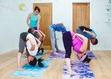 Iriness yoga class Padotanasana